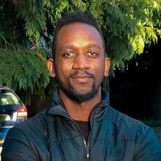 Ezekiel Imani headshot